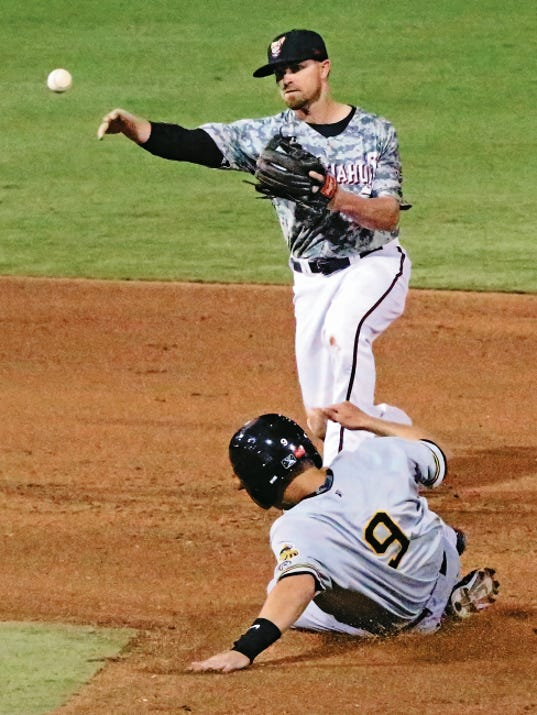 Rudy Gutierrez—El Paso Times Infielder Mike McCoy, top, of the El Paso Chihuahuas throws to first base for a double play as he steps on second base before Alex Yarbrough, 9, of the Salt Lake Bees Saturday at Southwest University Park.