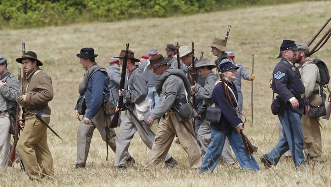 Union and Confederated soldiers head back to the camps at the conclusion of a battle during the annual Civil War reenactment at Willamette Mission State Park in 2014. The event is moving to Antique Powerland July 2-4.