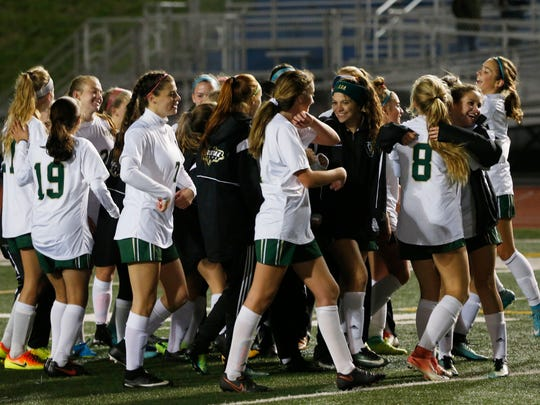Vestal's girls soccer team celebrates their victory over Maine-Endwell in Thursday's Section 4 Class A final at Binghamton on October 26, 2017.