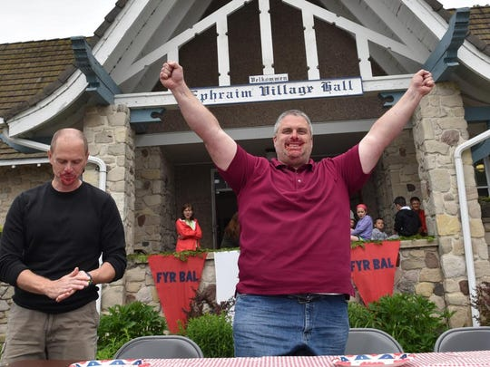 Kevin Olson of Colfax celebrates his win in the 18-and-older division of the cherry pie eating contest at the 2015 Fyr Bal.