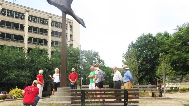A group from the prayer vigil gathered outside City Hall on Saturday morning to offer prayers.