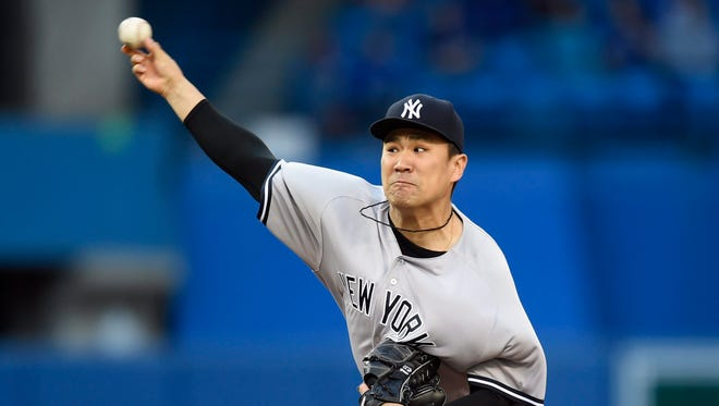 New York Yankees' Masahiro Tanaka throws against the Toronto Blue Jays during the first inning of a baseball game, Wednesday, June 1, 2016, 2016 in Toronto.