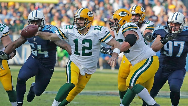 Green Bay Packers quarterback Aaron Rodgers (12) runs for a touchdown against the Tennessee Titans at Nissan Stadium.