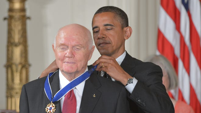 President Obama presents the Presidential Medal of Freedom to astronaut and former senator John Glenn during a ceremony at the White House May 29, 2012.The award is the country's highest civilian honor.
