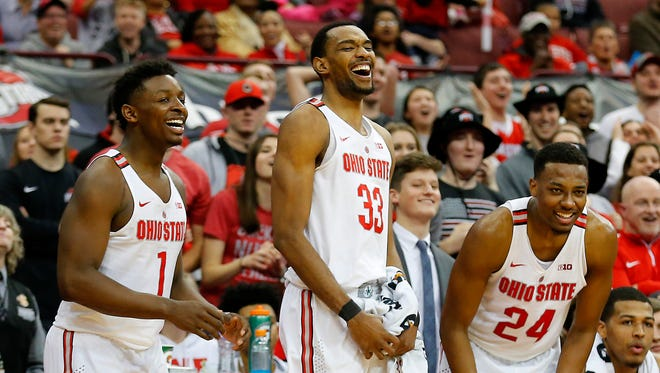 Feb 10, 2018; Columbus, OH, USA; Ohio State Buckeyes forward Keita Bates-Diop (33) celebrates his three point play with forward Andre Wesson (24) and forward Jae'Sean Tate (1) during the second half against the Iowa Hawkeyes at Value City Arena. Mandatory Credit: Joe Maiorana-USA TODAY Sports