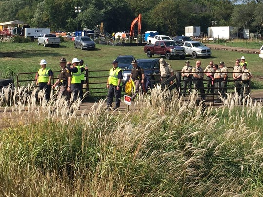 State troopers, Boone County sheriff's deputies and private security workers gathered Thursday, Sept. 22, 2016, near Pilot Mound, Ia., where about 175 people protested the construction of the Dakota Access Pipeline.