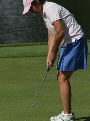 Cathy Almquist makes a putt during play in the 2011 Metropolitan Women's Amateur.