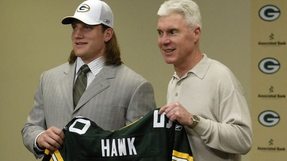 A.J. Hawk shows off his new jersey after being selected fifth overall in 2006 by the Green Bay Packers. The newest Bengal will be our guest on Beyond The Stripes on April 23.