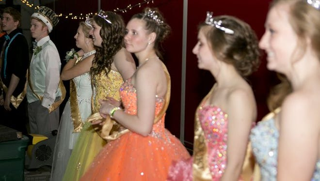 The prom court lines up during the prom at the Stevens Point Area Senior High School field house, Saturday, April 25, 2015.