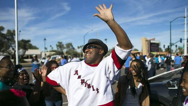 Gary Jenkins of San Tan Valley, dances while waiting with others from the Mt Calvary Baptist Church of Mesa, to march in the Mesa MLK Celebration parade along Center Street in Mesa on Martin Luther King Day on Monday, Jan. 20, 2015.