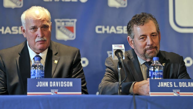 John Davidson, left, and James Dolan, owner of the New York Rangers, are in the minority in the sports world, taking a silent approach as racial unrest continues. SETH WENIG/AP