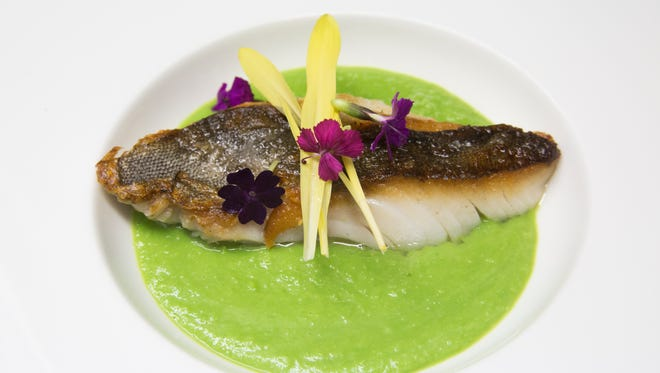 The crispy savel fish dish served with a spring-pea puree is part of Essense at Two Bunch Palms Resort's new menu, coming to the restaurant April 1.