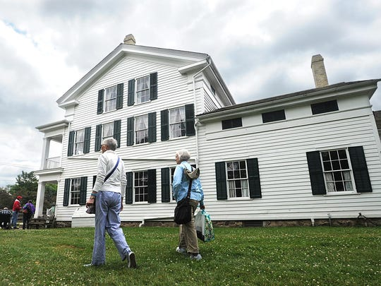 Susan McFadden and Andrea Tatlock of Appleton walk the grounds of the Wade House in Greenbush.