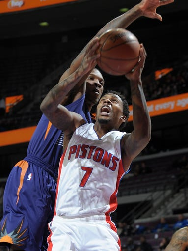 Pistons guard Brandon Jennings shoots over Suns guard
