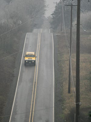 A SUV heads east along Hylo Road SE on Wednesday Dec. 20, 2006. A one vehicle collision left one dead and two injured. Photo by Timothy J. Gonzalez
