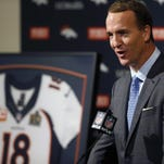 Peyton Manning speaks during a news conference Monday in Englewood, Colo., where he announced his retirement from professional football.