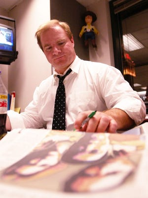 Rick Green works on election coverage in the Enquirer newsroom in this 2003 photo.