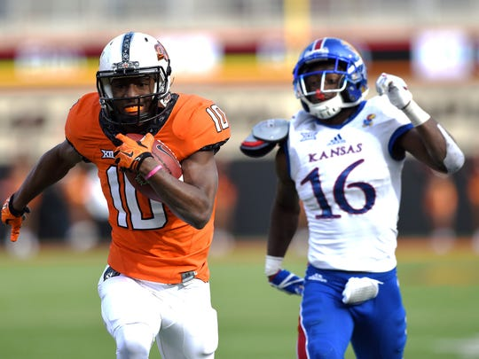 Oklahoma State wide receiver Tyrell Alexander, left, has joined Vanderbilt as a graduate transfer.