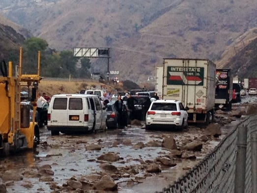 Vehicles are stopped in mud on California's Interstate-5