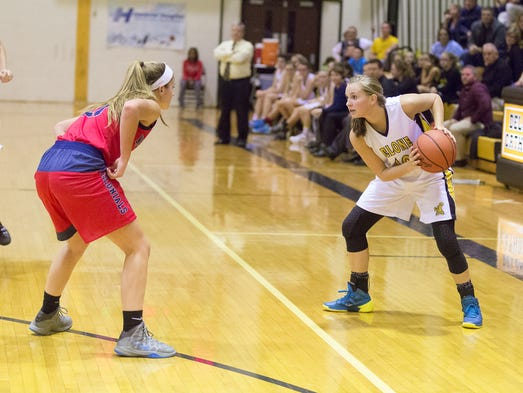 Delone's Riley Vingsen pauses while being guarded by