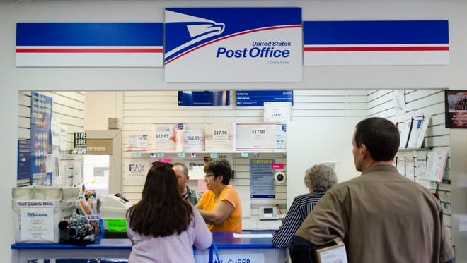 The Mailroom, an independent, locally-owned mail contract station for the USPS on N. Wheeling Avenue, seen Nov. 4, 2015, recently underwent upgrades to its system to give customers a better post-mailing experience, including faster tracking services and extended options for delivery.