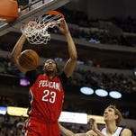 New Orleans Pelicans forward Anthony Davis (23) dunks in front of Dallas Mavericks forward Dirk Nowitzki (41) during the first half of an NBA basketball game earlier this month.