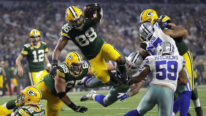 Green Bay Packers running back Ty Montgomery leaps for a rushing touchdown during Sunday's NFC divisional playoff game against the Dallas Cowboys at AT&T Stadium in Arlington, Texas.
