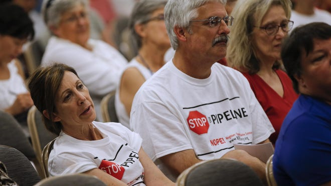 Duke Energy officials, Hamilton County commissioners, elected officials and community members attend a meeting with community leaders along the proposed pipeline route, Wednesday, July 27, 2016, at the Sharonville Convention Center.