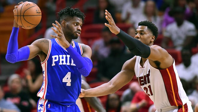 Philadelphia 76ers forward Nerlens Noel (4) is guarded by Miami Heat center Hassan Whiteside (21) during the second half at American Airlines Arena.