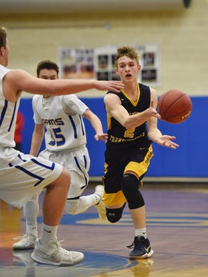 The Kennard-Dale defense forces Littlestown's Jakob Lane to pass during Thursday's District 3 playoff game.