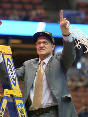 Oklahoma Sooners coach Lon Kruger cuts the net following the 80-68 victory against Oregon Ducks to win the West regional final of the NCAA tournament at Honda Center.