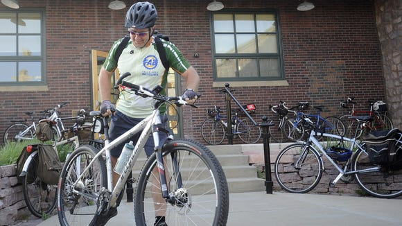 Jeff Rohlena takes part in the bike to work day at Museum of Visual Materials in Sioux Falls on Friday, May 18, 2012.