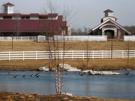 A stable and exercise ring at Primatara, a 300-acre ranch that is a working cattle farm and thoroughbred farm, owned by Robert Low and his wife Lawana.