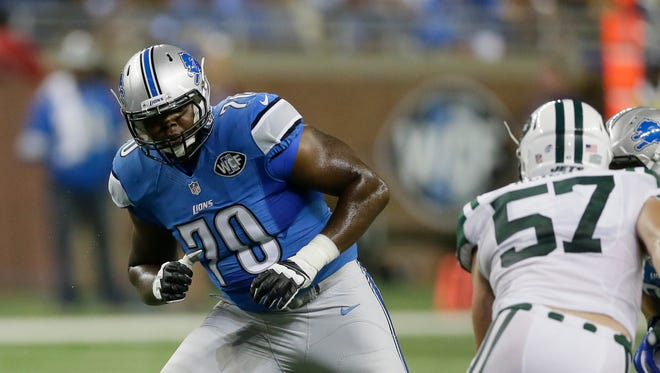 Detroit Lions tackle Corey Robinson (70) takes position against the New York Jets on Aug. 13, 2015, in Detroit.