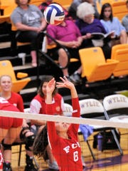 Wylie's Gracie McCaslin (6) sets the ball for the South during the Big Country FCA All-Star volleyball game at Wylie's Bulldog Gym.