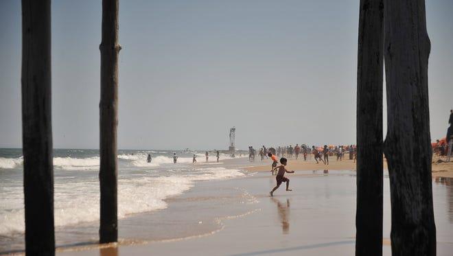 Kids play in the waves in Ocean City, Md., during Memorial Day weekend 2016.