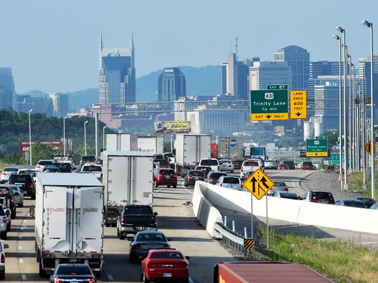 Morning traffic heads southbound on Interstate 65 near