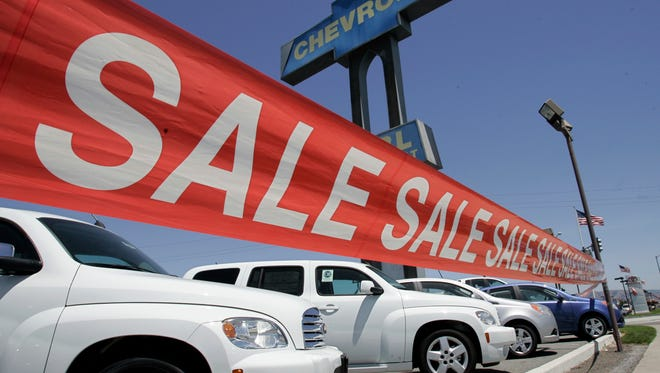 vehicles on display at a Chevrolet dealership in San Jose, Calif. in a 2009 file photo
