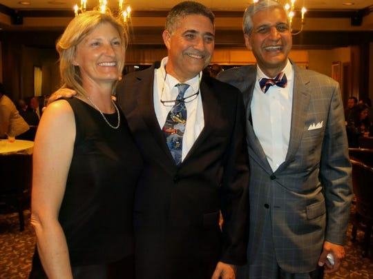 Woodard Symposium honorees Dr. Kate Drummond, of Melbourne, Dr. Yigal Shoshan, of Jerusalem, and Dr. Anil Nanda at Shreveport Club party.