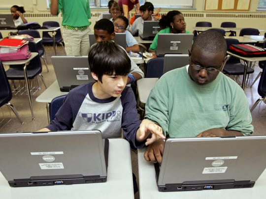 Seventh grade students John Miller, left, and Fred Inmon, right, work on laptops during a high school transition class at KIPP Academy in Nashville Wednesday, October 8, 2008.