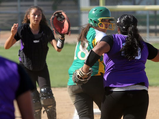 Coachella Valley's Cassandra Camacho escapes the rundown to get back onto third base at the bottom of the 6th inning against Shadow Hills on Thursday, May 18, 2017 in Thermal during the first round of the CIF SS softball tournament.