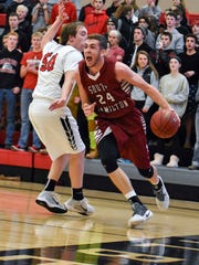 South Hamilton senior Collin Hill dribbles down the court during the basketball game against Gilbert on Friday, Jan. 13, 2017 at Gilbert High School in Gilbert.