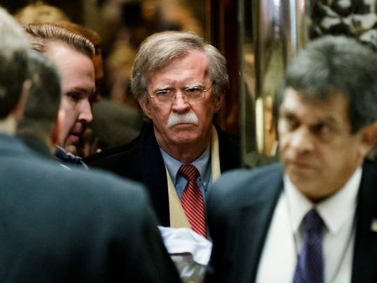 John Bolton (C) arrives for a meeting with US President-elect Donald Trump at Trump Tower in New York, New York in 2016.