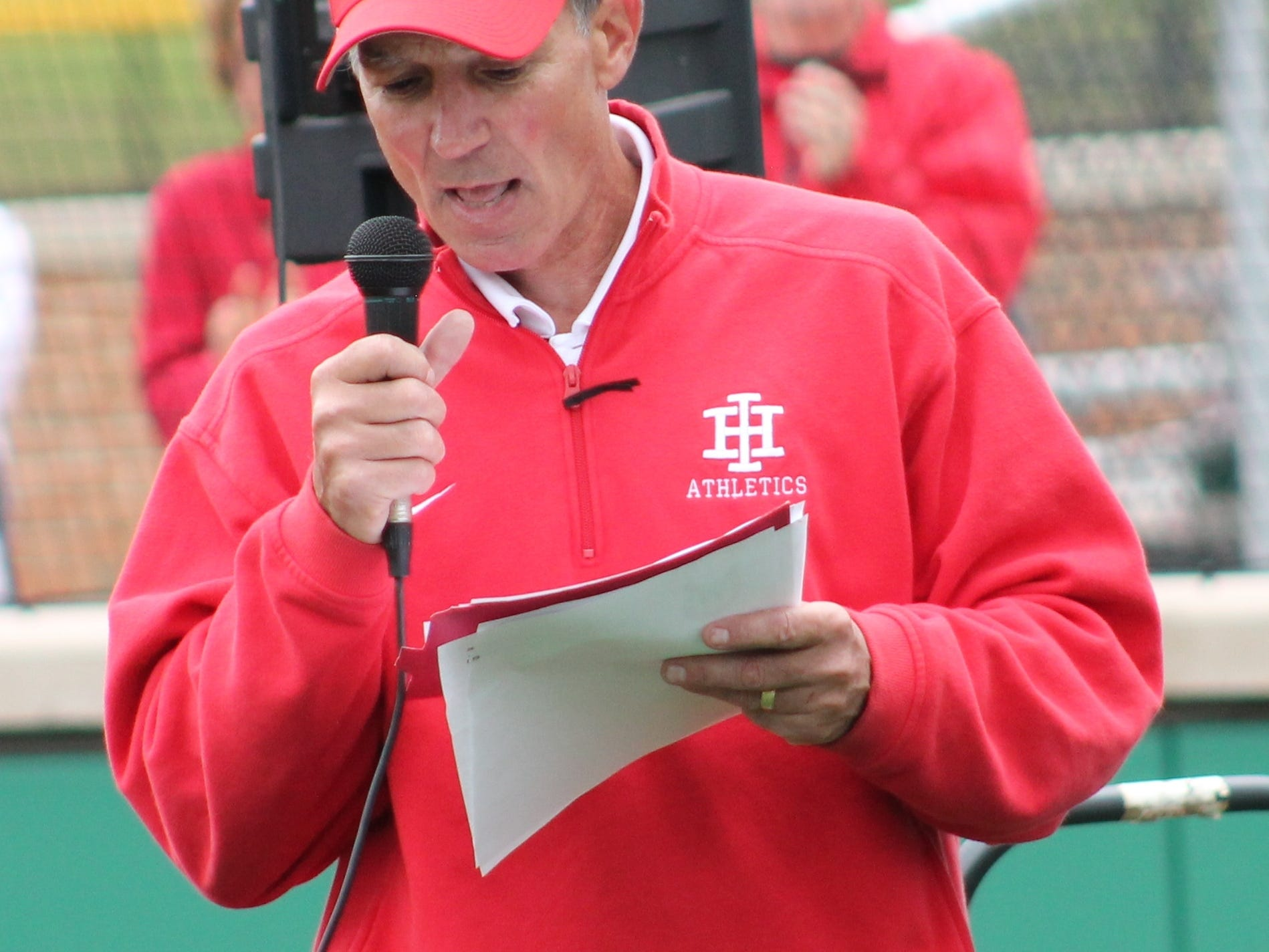 Indian Hill athletic director Jeff Zidron handles the PA duties at the dedication of the baseball/softball complex April 20.