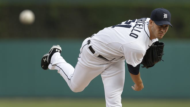Detroit Tigers pitcher Rick Porcello throws a warm-up pitch against the Minnesota Twins on Aug. 20, 2013.