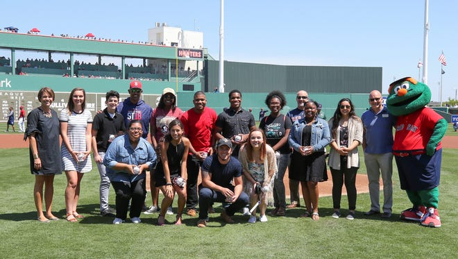 The Boston Red Sox honored 13 local high-school seniors, presenting them each a $5,000 college scholarship by the Red Sox Foundation on Saturday, March 24.