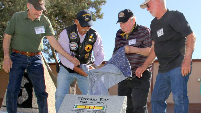 Vietnam veterans representing branches of the US armed forces unveiled a new memorial monument on Friday tat Veterans Park o honor those who served during the Southeast Asian conflict.