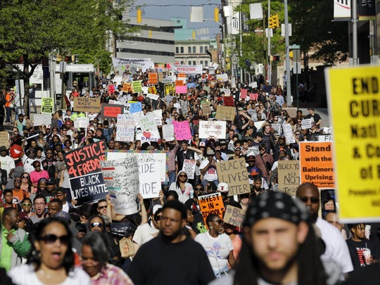 Protesters march through Baltimore on May 2, the day after charges were announced against police officers in the death of Freddie Gray.