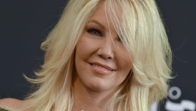 Actress Heather Locklear arrives at the screening of 'Too Close to Home' on Aug. 16, 2016 in Beverly Hills.