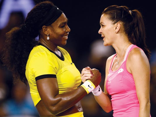 Serena Williams, left,  of the United States is congratulated by Agnieszka Radwanska of Poland after winning their semifinal match at the Australian Open tennis championships in Melbourne, Australia, Thursday, Jan. 28, 2016.(AP Photo/Rafiq Maqbool)